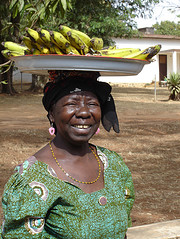 African Lady Carrying Bananas
