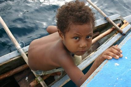 papua boy in boat
